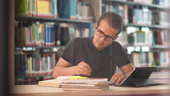 Student Working in the University Library