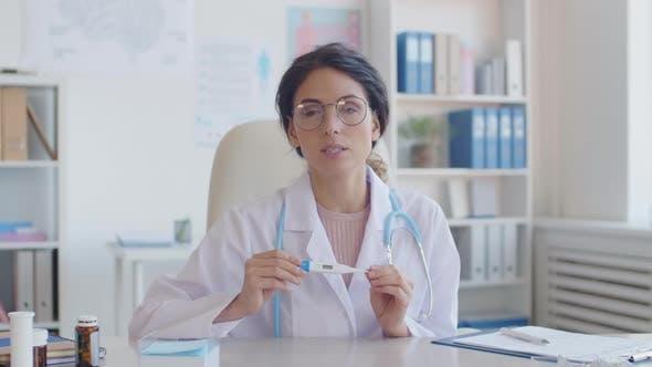 Thumbnail for Female Doctor Giving Online Consultation