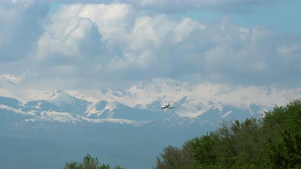 Thumbnail for Business jet plane approaching against mountains