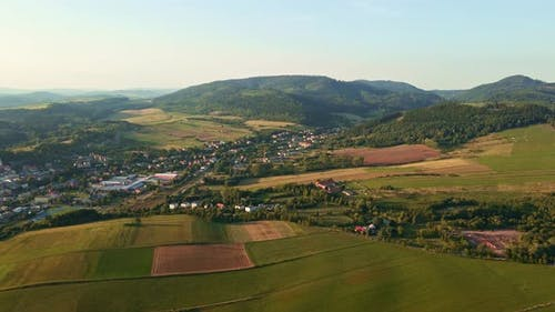 Landscape with Mountains Green Fields and Countryside Village Aerial View