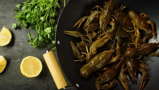 Live Uncooked Crayfish in a Saucepan Stir.
