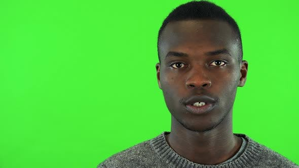 Cover Image for A Young Black Man Talks To the Camera - Face Closeup - Green Screen Studio