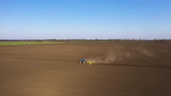 Thumbnail for Tractor Plowing Agricultural Land
