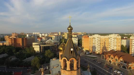 Thumbnail for Aerial Shot of City Streets with Houses and Church at Sunset, Russia