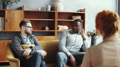Multiethnic Boyfriends Speaking with Female Counselor during Couple Therapy