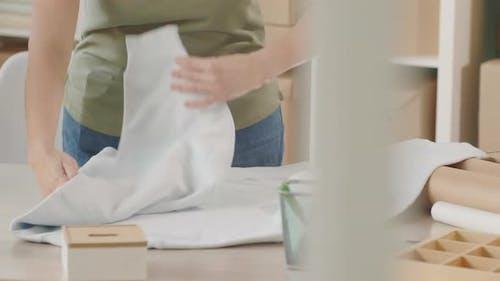 Seller Folding Hoody for Sending to Online Shopper
