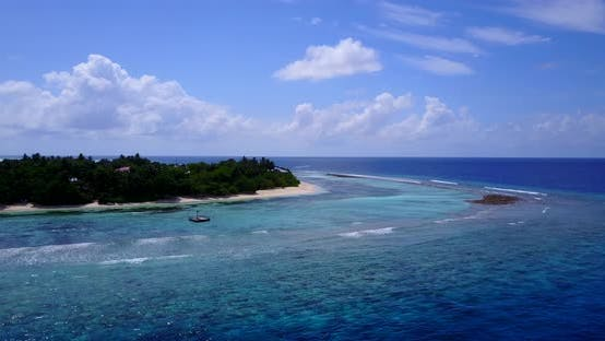 Thumbnail for Tropical flying clean view of a summer white paradise sand beach and aqua blue water background in b