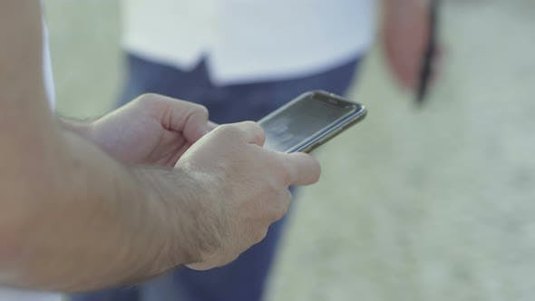 Thumbnail for Closeup Shot of Male Hands Typing Message on Smartphone