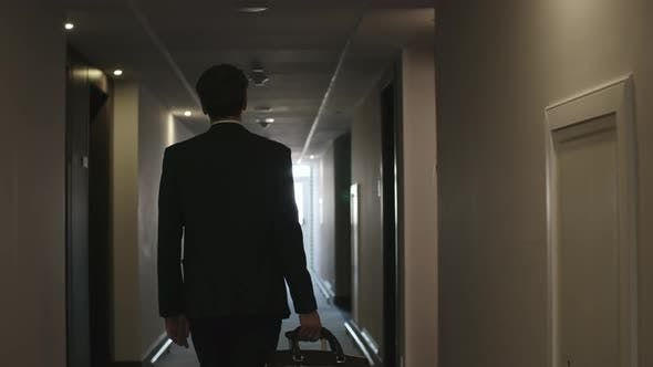 Thumbnail for Man Walking with Luggage to Hotel Room