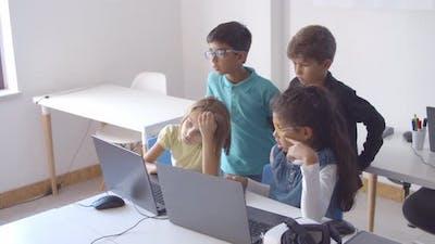 Classmates Doing School Task Together