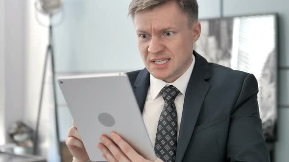 Thumbnail for Businessman Reacting To Loss on Tablet