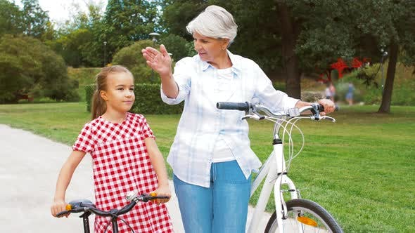 Grandmother and Granddaughter with Bicycles 4