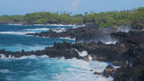 Waves crashing into shore on Hawaii