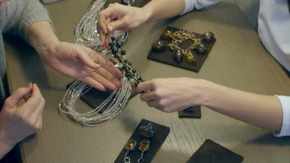 Thumbnail for Female Seller Helps Elegant Woman To Try on an Expensive Bracelet