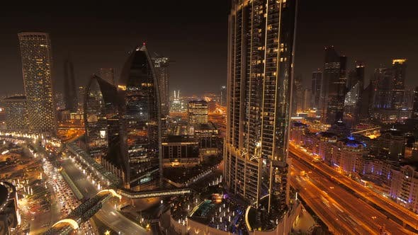 Thumbnail for Illuminated City Skyline Buildings and Roads at Night