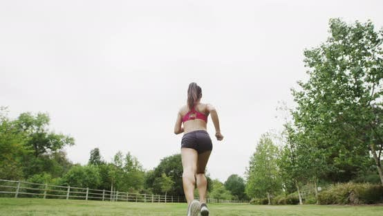 Thumbnail for Healthy young Asian woman running and jumping at the park