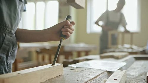 Man with Chisel and Hammer