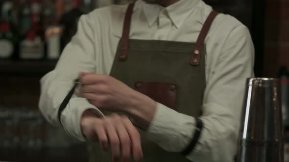 Thumbnail for Barman Puts on the Uniform and Starts Work in the Bar