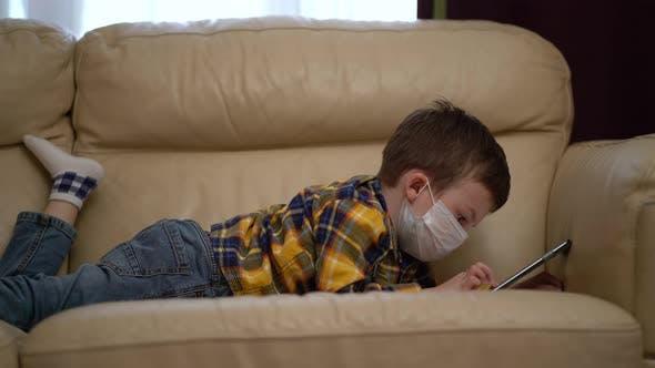 Thumbnail for Boy Medical Mask on Face Due To Coronavirus Outbreak