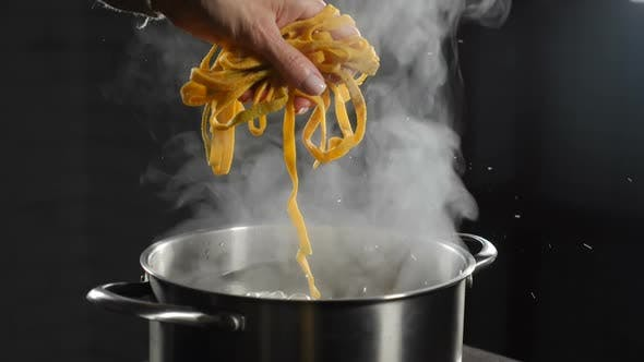 Putting Raw Pasta Into Boiling Water