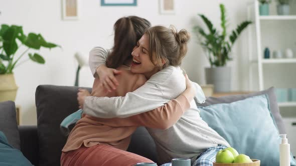 Thumbnail for Happy Women Taking Medical Masks off, Smiling and Embracing at Home