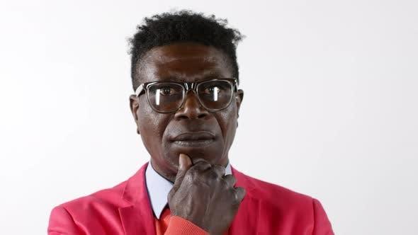 Thumbnail for Pensive African Man in Elegant Suit Posing for Camera