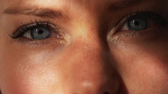 Model Opening Her Blue Eyes