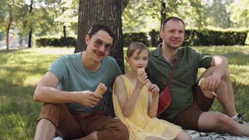 Family Relaxing In Park