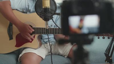 Boy Playing Guitar While Live Streaming