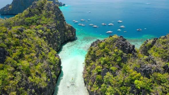 Thumbnail for Big Lagoon, El Nido, Palawan, Philippines. Drone Aerial Fly Between Limestone Cliffs Above Shallow