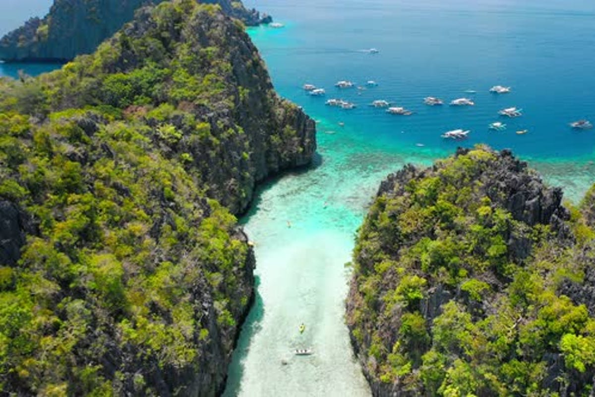Big Lagoon El Nido Palawan Philippines Drone Aerial Fly Between Limestone Cliffs Above Shallow By Shunga Shanga On Envato Elements