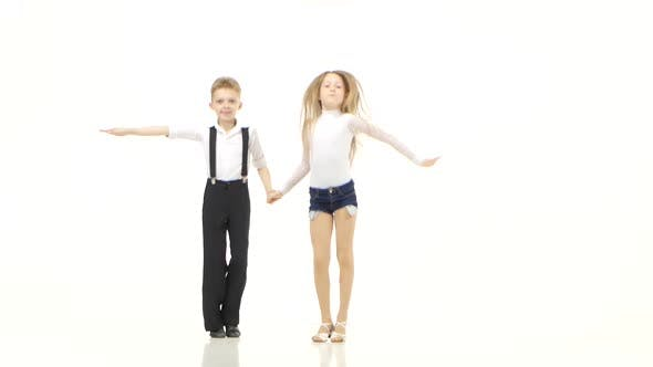 Thumbnail for Little Dancers in Beautiful Costumes Perform a Retmic Dance