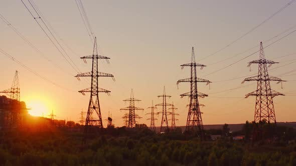 High voltage electric towers at sunset
