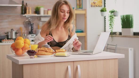 Woman in Lingerie Typing on Laptop