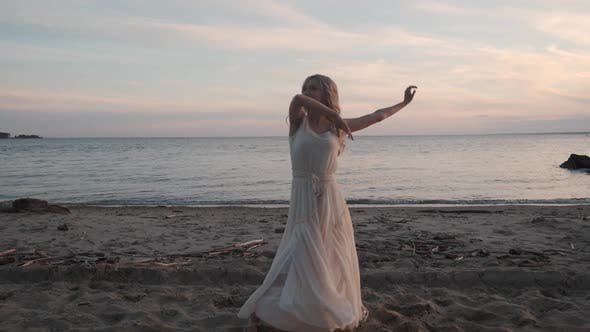 Thumbnail for Graceful Girl Dancing on the Beach at Sunset
