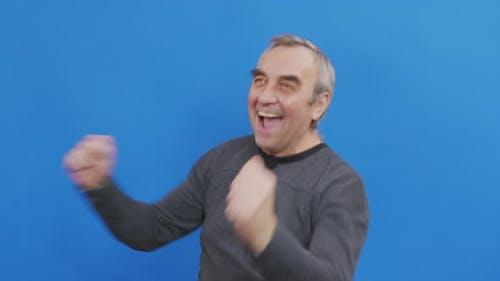 Happy Fun Mature Man Rejoices Dances Isolated Blue Background Studio