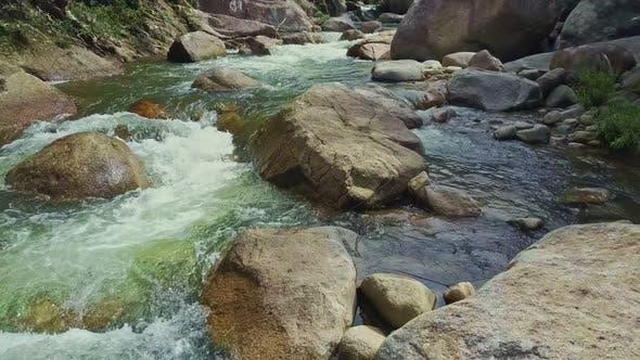 Closeup Stormy Mountain River Runs Between Boulders