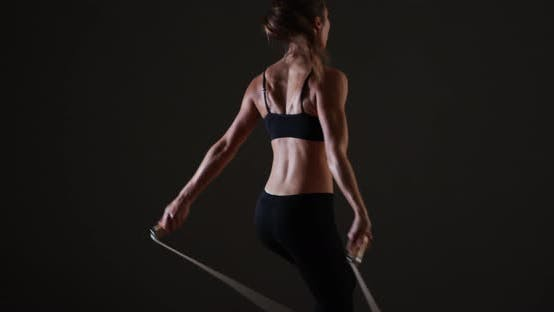 Thumbnail for Healthy fit mixed race woman jumping rope