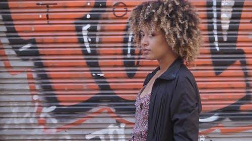 Stylish Black Woman Against Graffiti