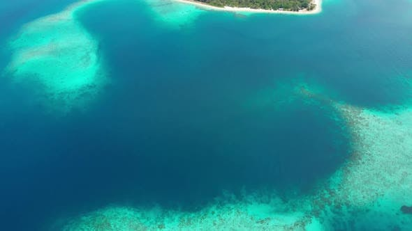 Aerial: flying over exotic tropical island secluded destination away from it all