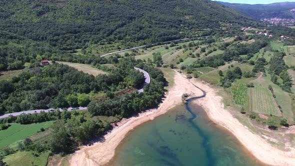 Thumbnail for Flying above forested shore of artificial lake Peruca, Croatia