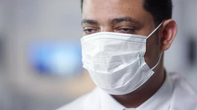 Unrecognizable Doctor In Mask