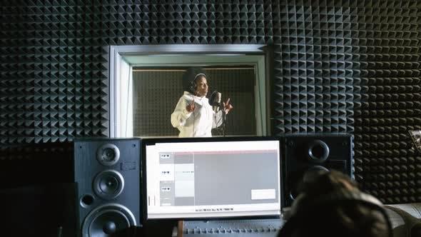 Thumbnail for Black Female Singer Recording Song in Studio