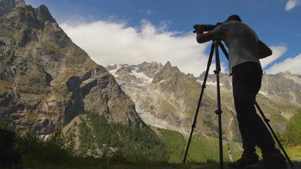 Nature Photographer Taking Pictures of Scenic Alpine Region