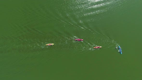 Group of Kayakers Bypassing Buoy during Water Competition