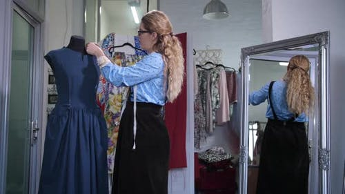 Seamstress Pinning Dress Neckline on Mannequin