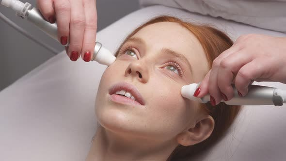 Close-up of a Woman's Face on a Hardware Skin Rejuvenation Procedure. Hardware Cosmetology