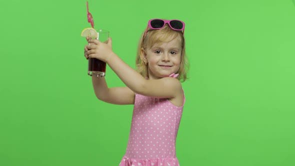 Thumbnail for Child in Pink Swimsuit Drinks Juice Cocktail with Drinking Straw. Chroma Key