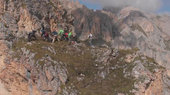 Thumbnail for Aerial Shot of a Group of Climbers Pull the Rope