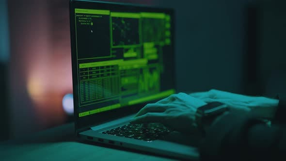 Hacker is Working on Laptop at Night